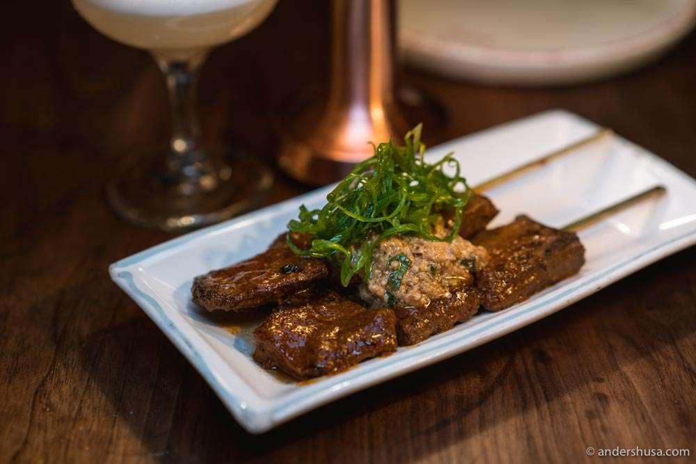 Corazon anticucho – beef heart skewers, rustic rocoto pepper, feta cheese, walnut sauce.