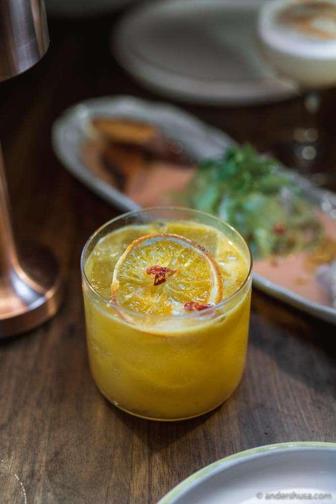 """Bellicose Warrior"" – citrusy, spicy mesquite-smoked pisco, aji amarillo, pineapple, lemon, curacao, kümmel."