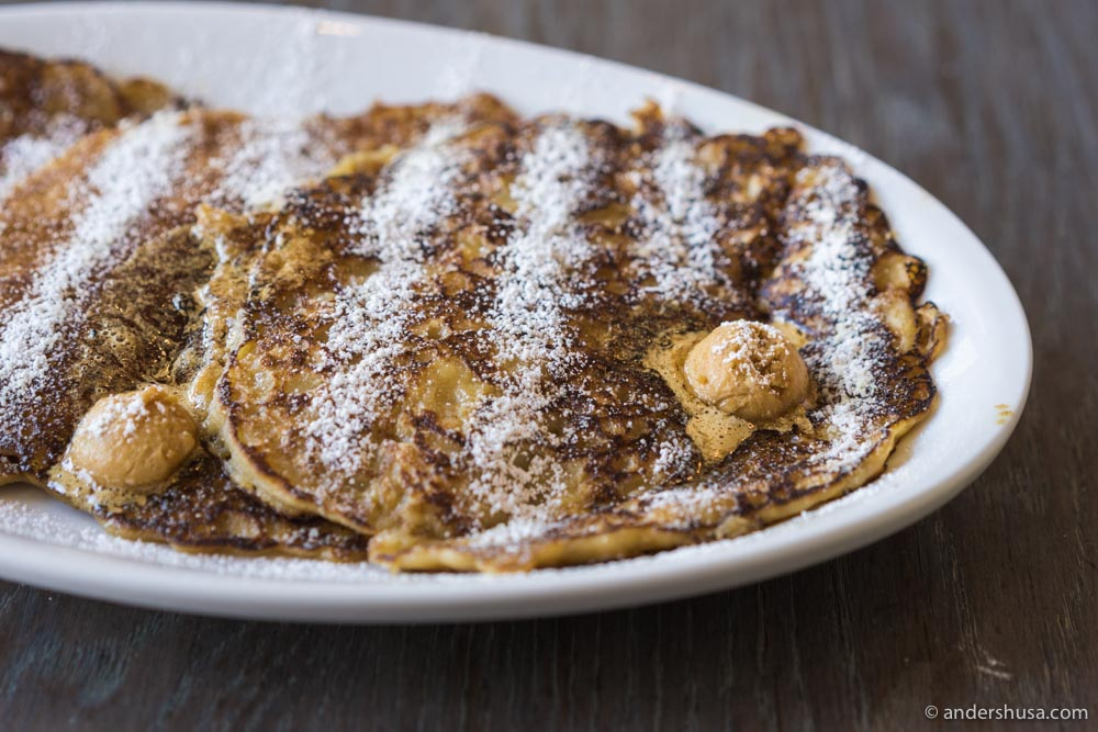 With a batter made of oatmeal, the griddle cakes are cooked thin and crispy around the edges.