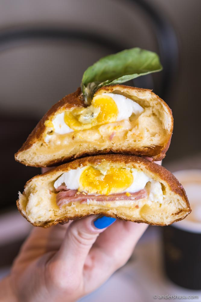 The Country Ham & Egg: a poached egg, ham, and basil hollandaise all stuffed inside a doughnut.