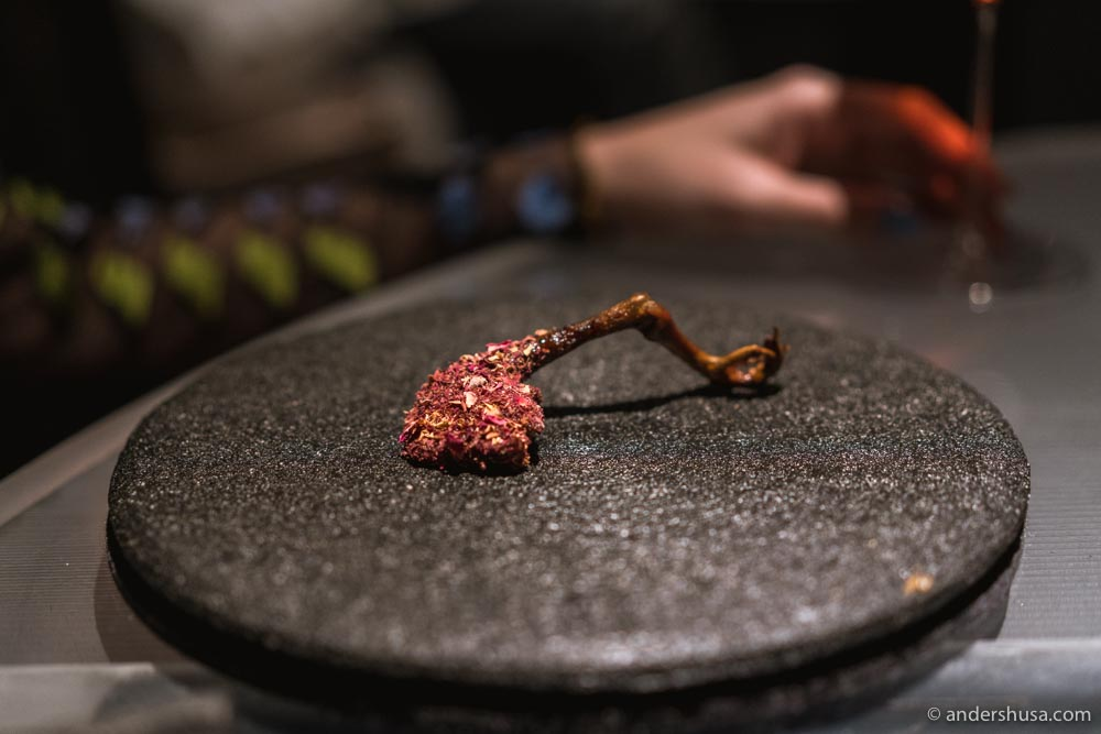 Leg of the squab, barbecued over the coals and brushed in rose petals.