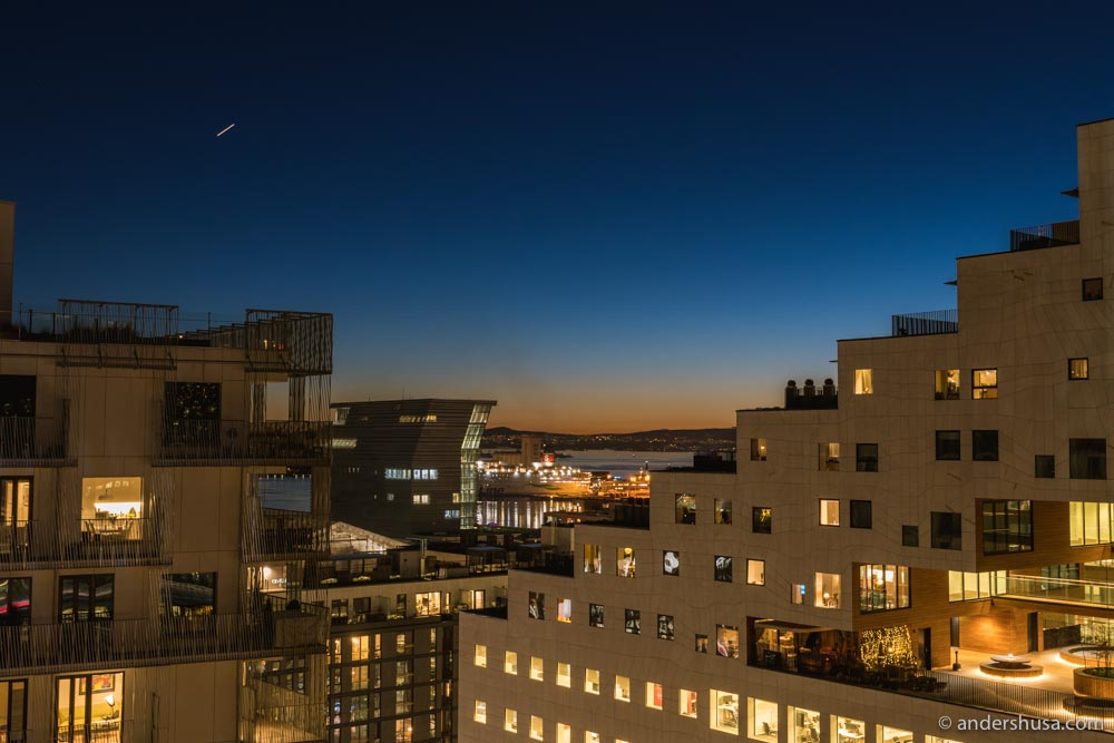 Watching the sun set from our private balcony in our Bjørvika apartment.