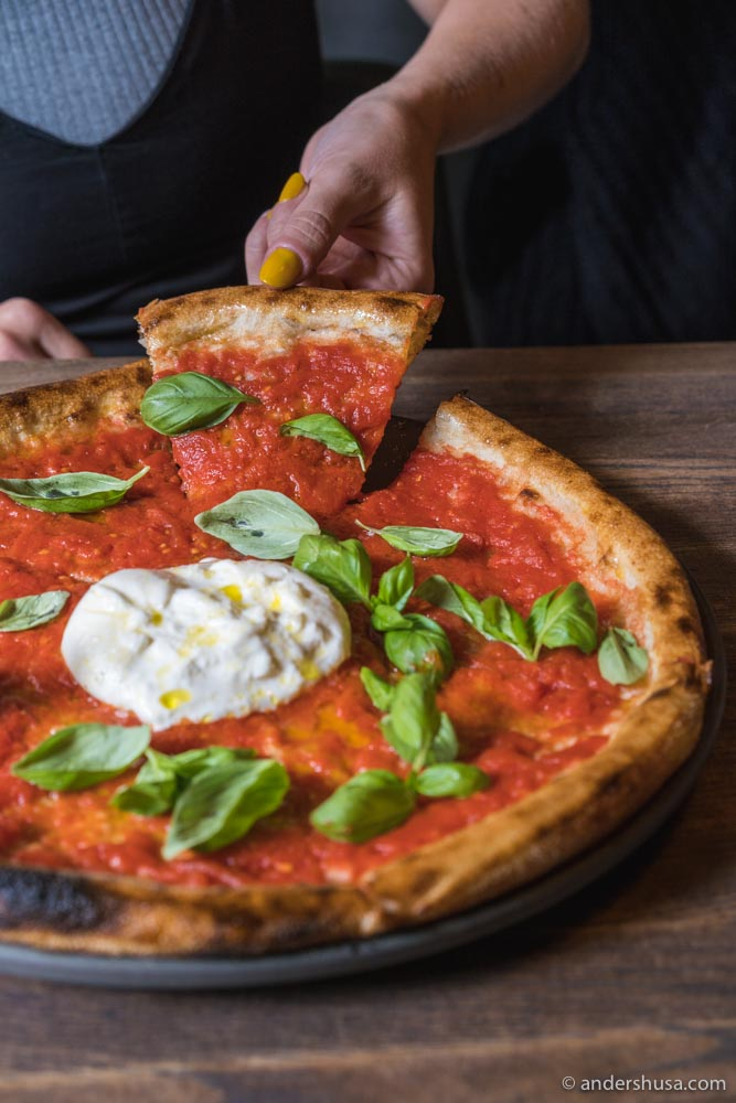The Margherita pizza with tomato, garlic, basil, and burrata.