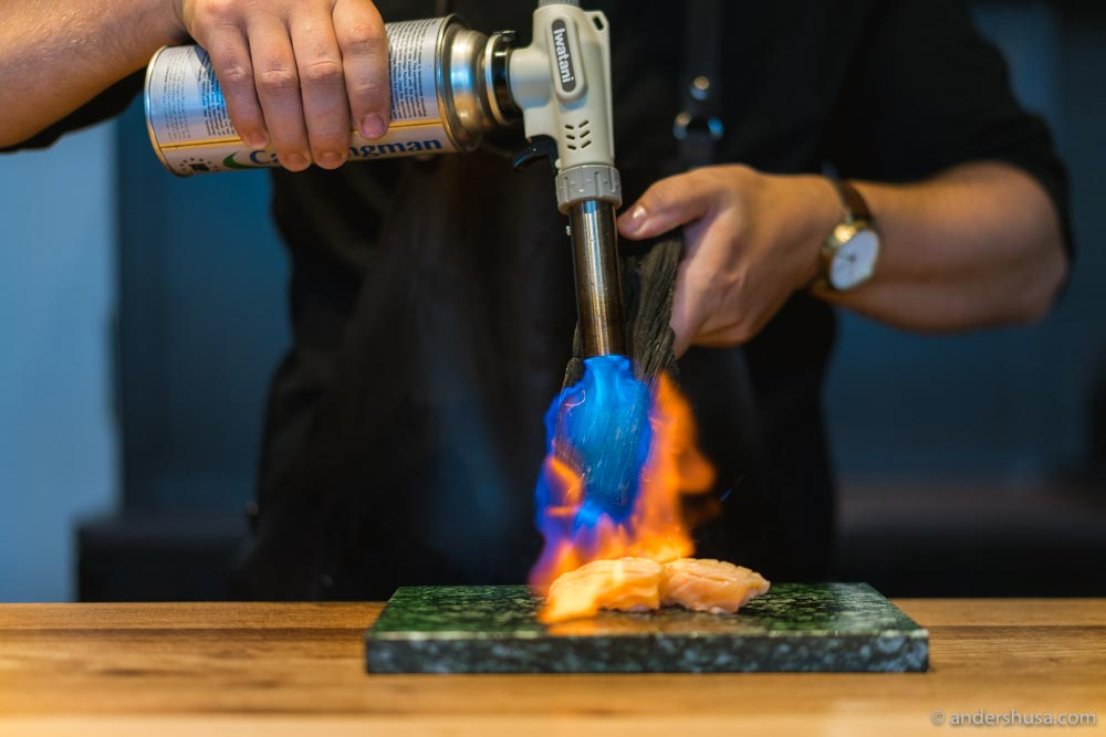 Torching the salmon belly.