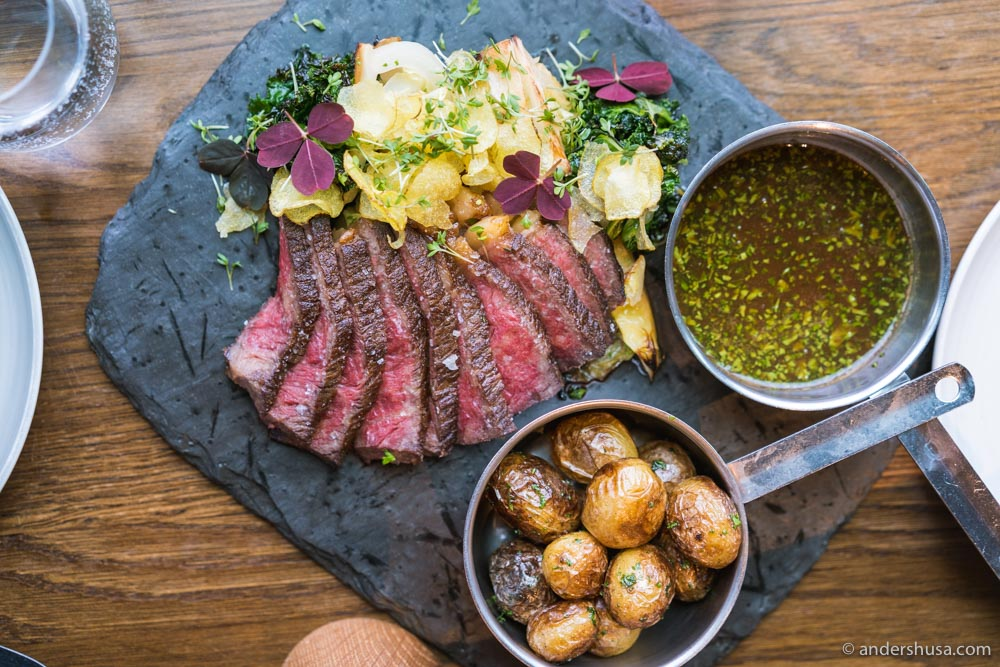 Perfectly cooked entrecote with a side of potatoes.