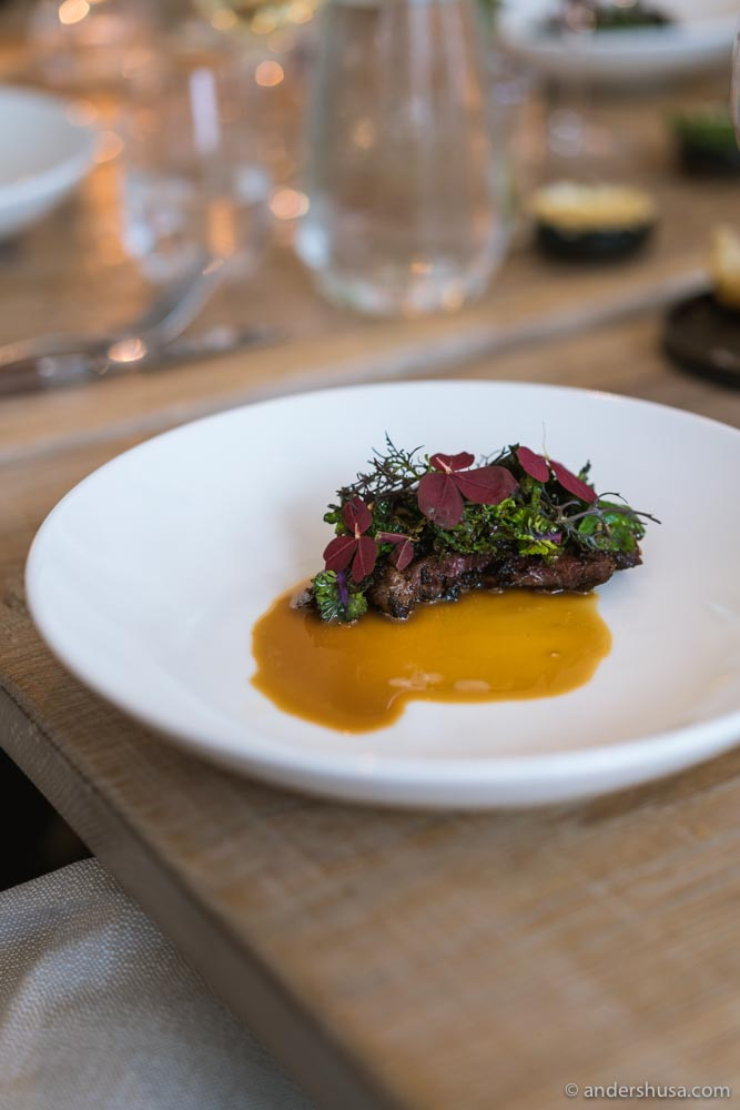 Dry-aged beef with flowers sprouts and oyster sauce.