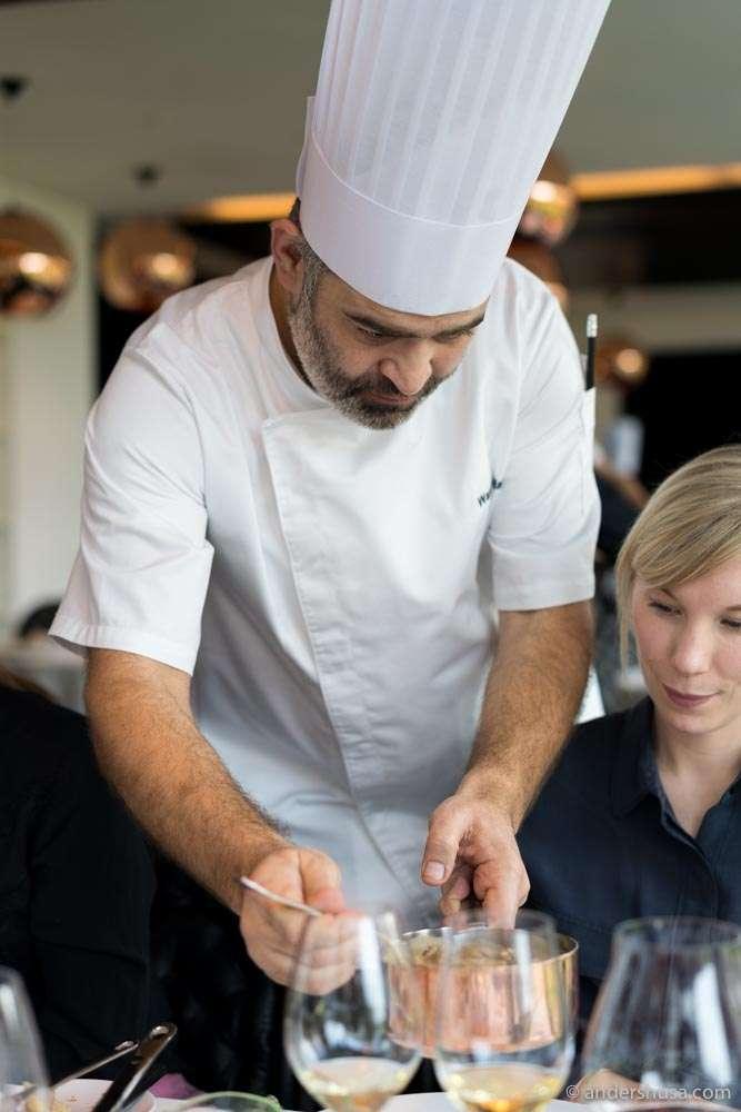 Chef Wassim Hallal plates a dish.