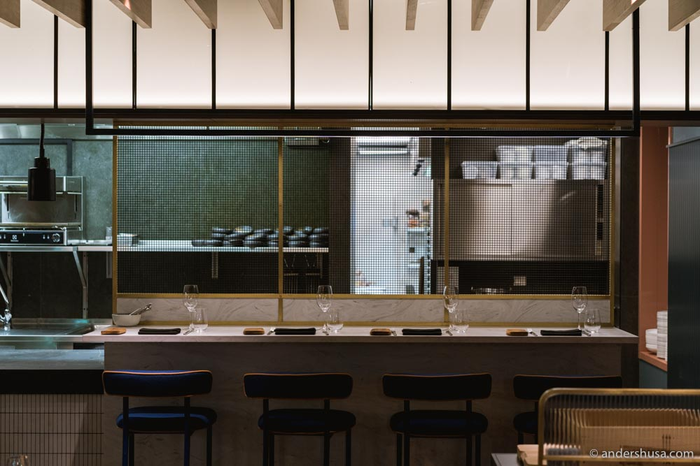 There are a few seats at the chef's counter.