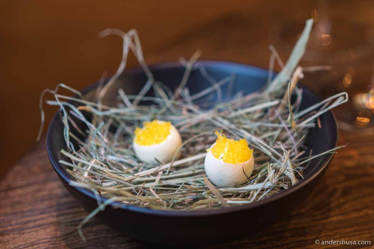 "An ""egg"" made of egg white powder, filled with smoked egg cream, chives, lemon, and cured egg yolk."