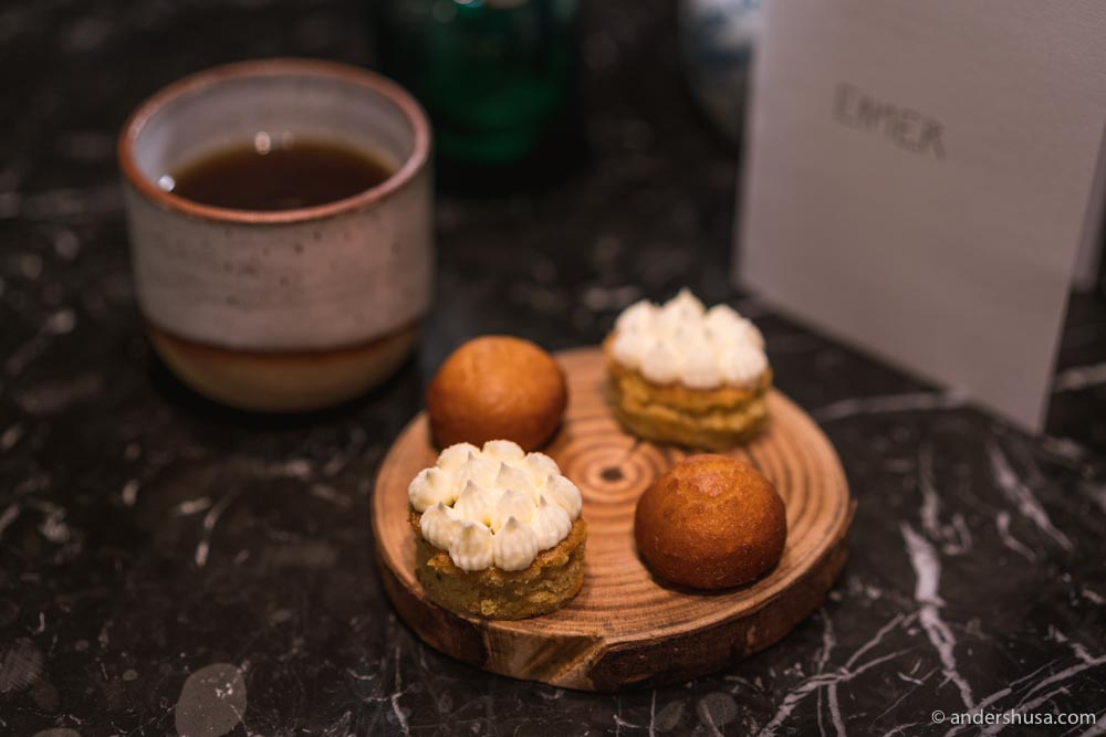 Petit fours: juniper carrot cake with buttercream, and a potato doughnut filled with lingonberries.