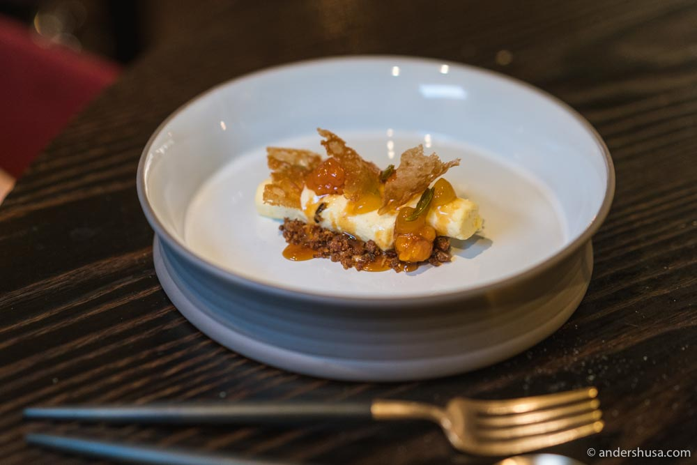 Cloudberry dessert with rye mousse, rye crisp, pine shoot syrup, and beer vinegar.