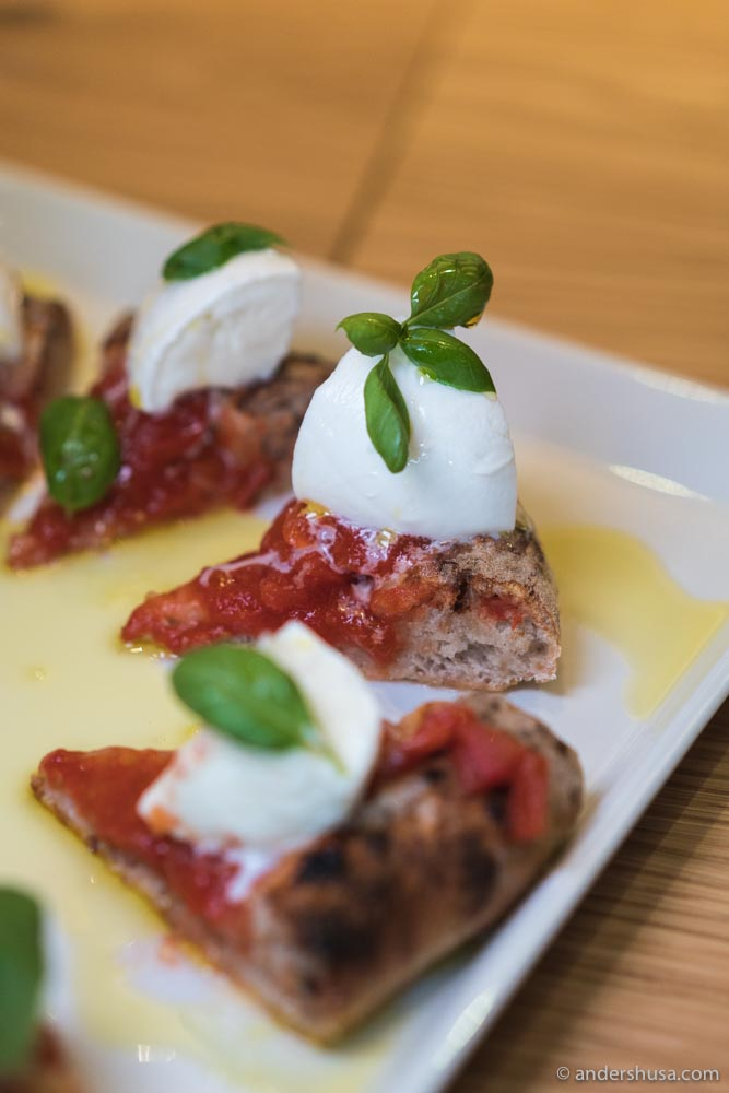 "The ""Bufala DOP"" with buffalo mozzarella, San Marzano tomatoes, and basil."
