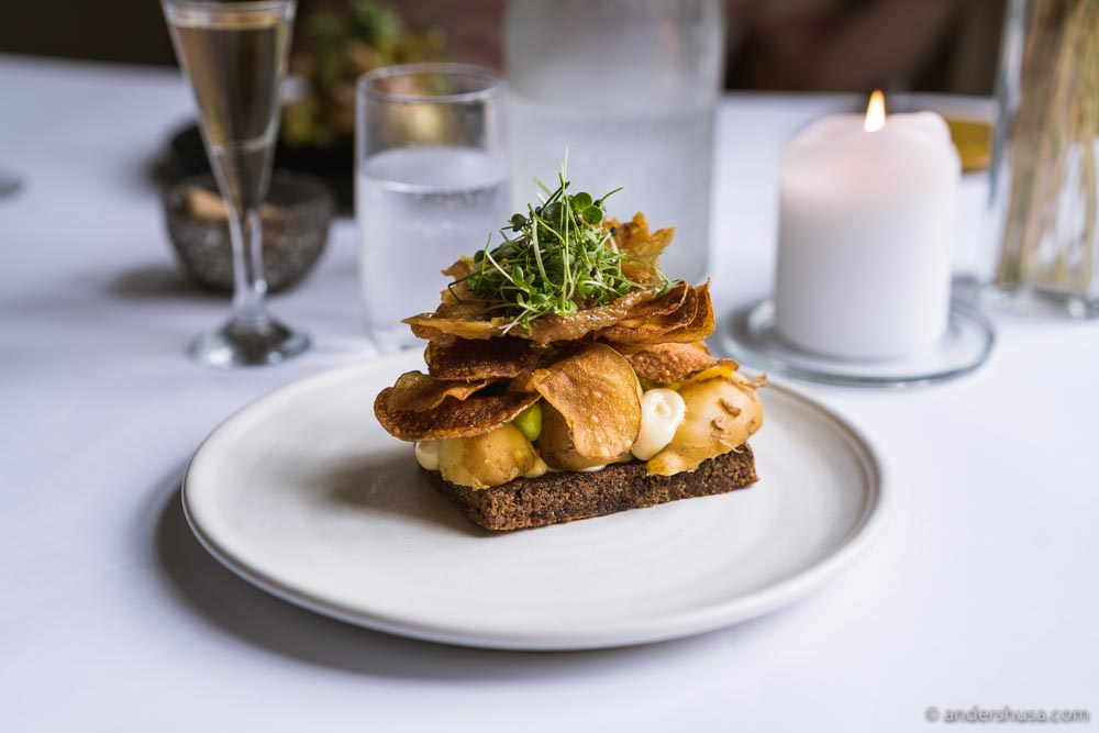 Our favorite smørrebrød was topped with smoked potatoes, chicken skin, potato chips, and mayo.