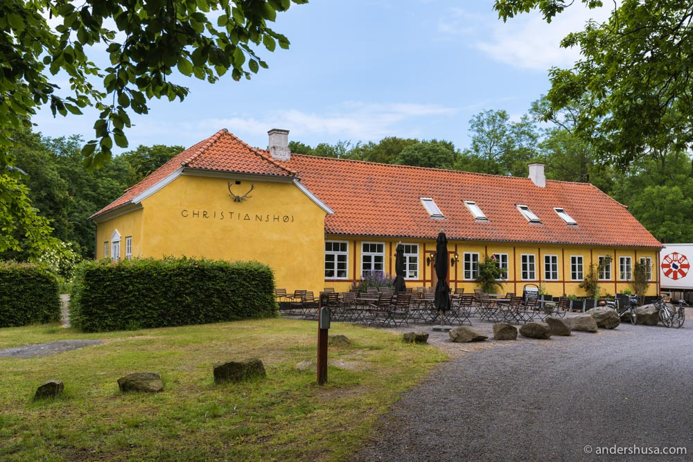Christianshøjkroen is a cozy yellow cottage in the middle of the forest.