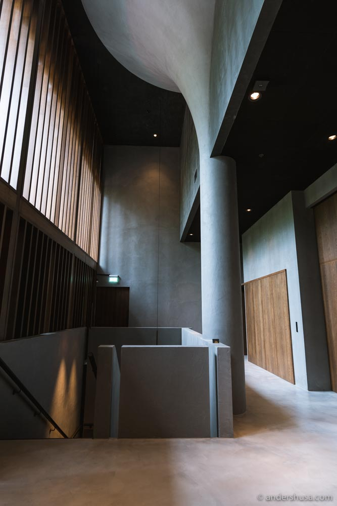 Is this the hallway of a restaurant, an art museum, or a modern cathedral?