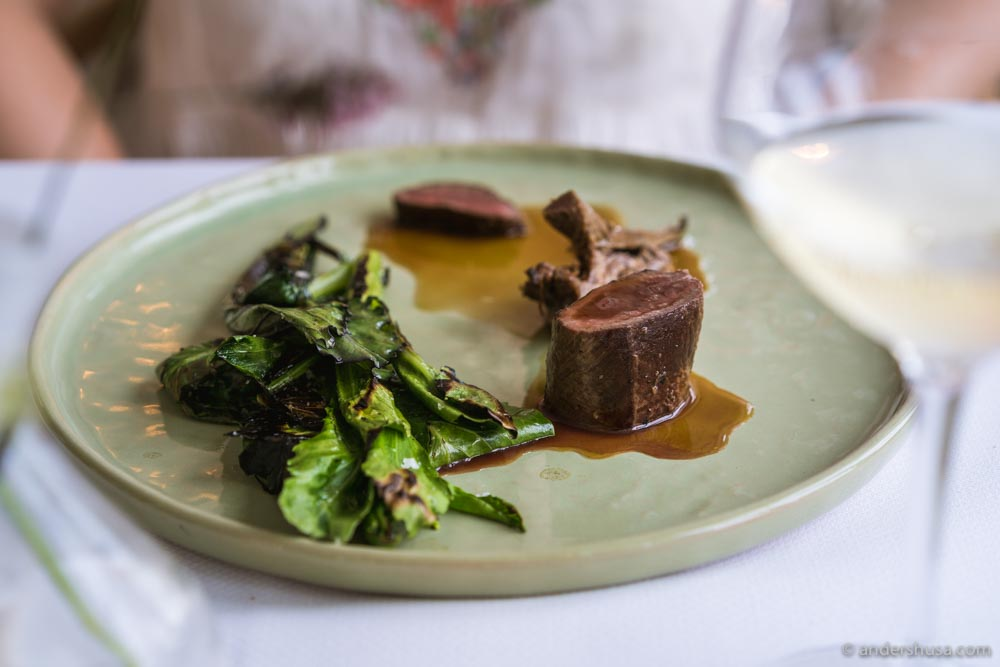 Veal with waldorf salad and cabbage shoots.