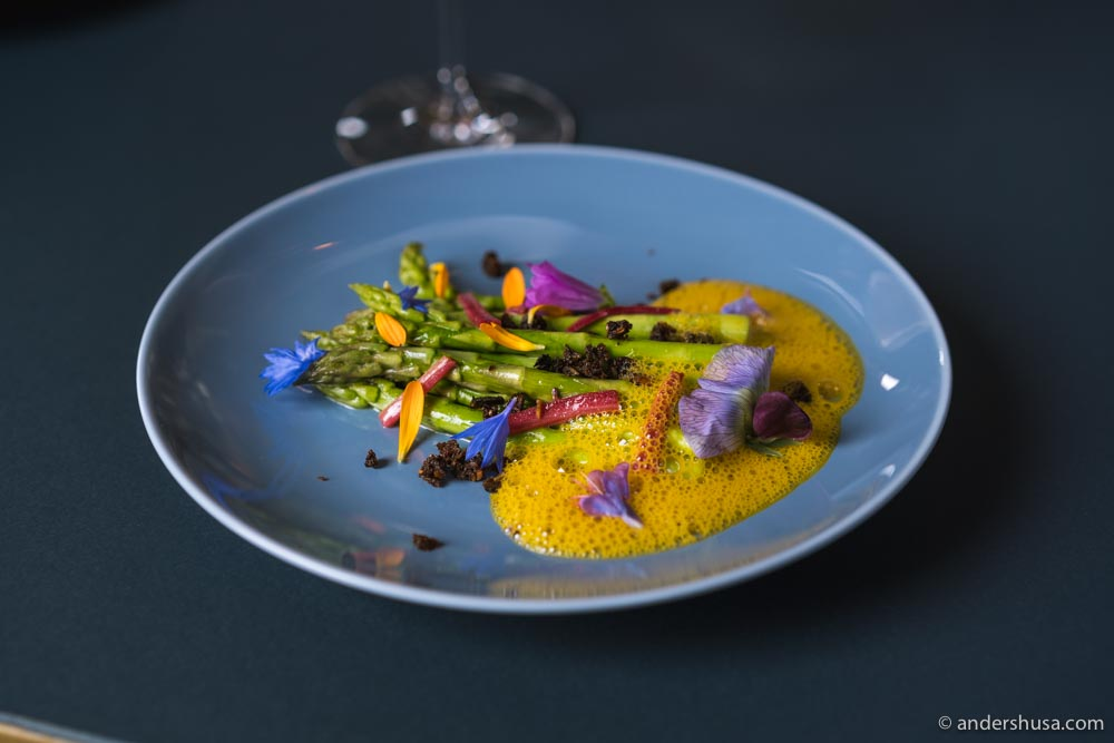 Green asparagus with rhubarb and rye crisps, in a brown butter sauce.
