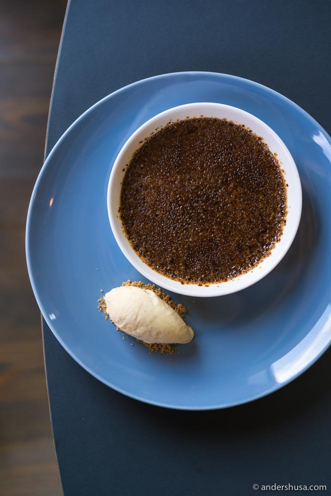Chocolate crème brûlée with vanilla ice cream.