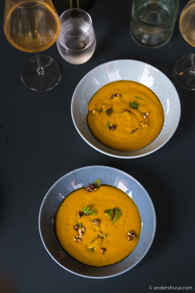 Cold carrot soup with walnuts.