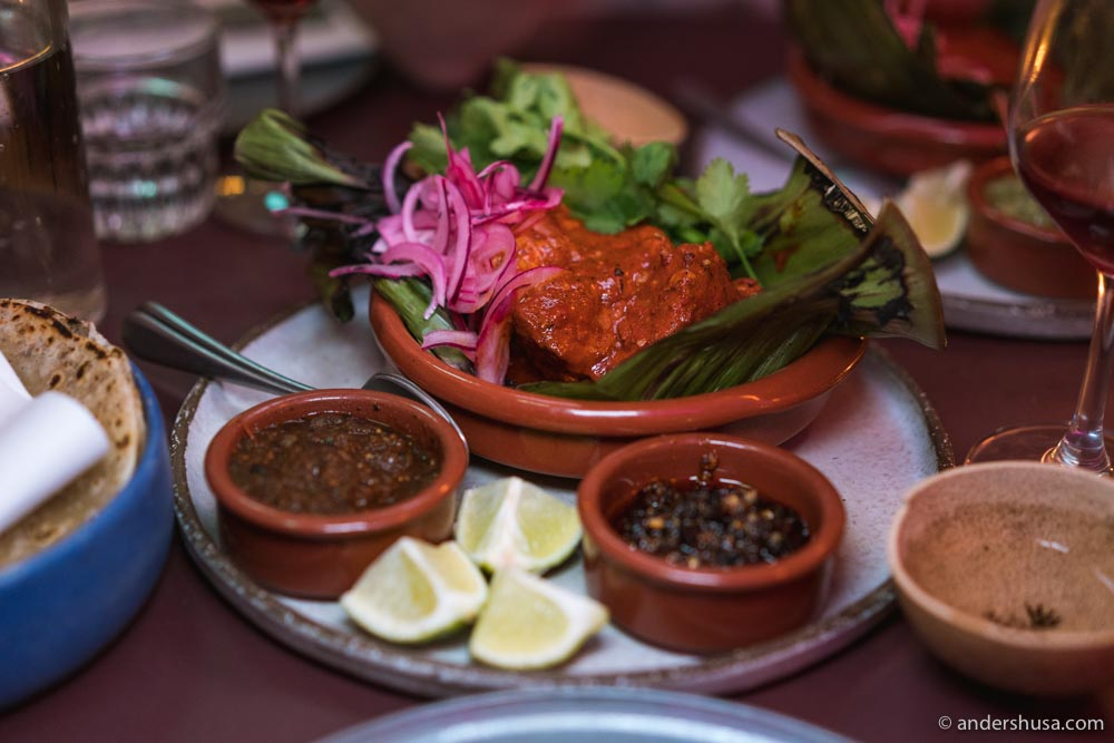Cochinita tacos – braised pork in recado rojo with pickled onion and salsa tatemada.