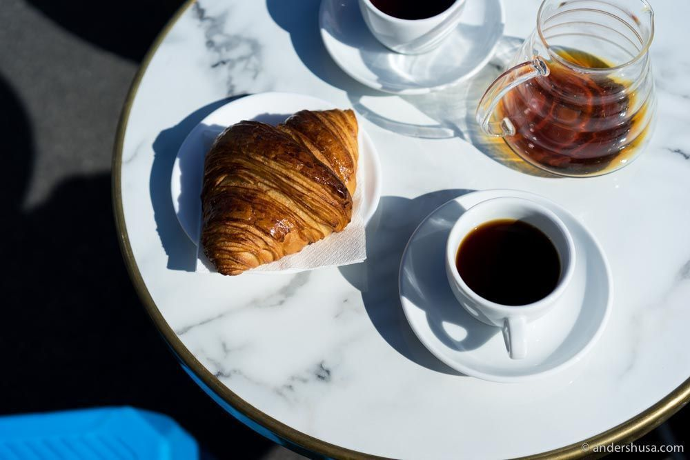 Pastries and coffee in the sunshine at Prolog Coffee Bar in Kødbyen.