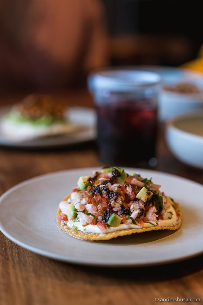Shrimp tostada with pico de gallo, habanero mayo, and avocado.