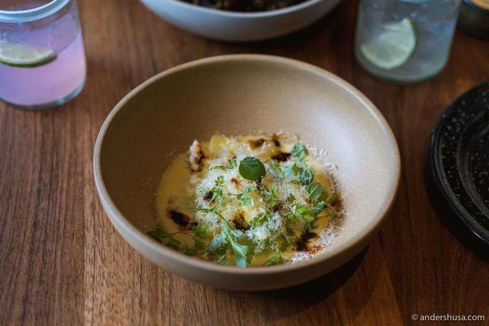 """""""Esquite"""" – kohlrabi, potato, cauliflower, aged cheese emulsion, salsa macha, and herbs."""