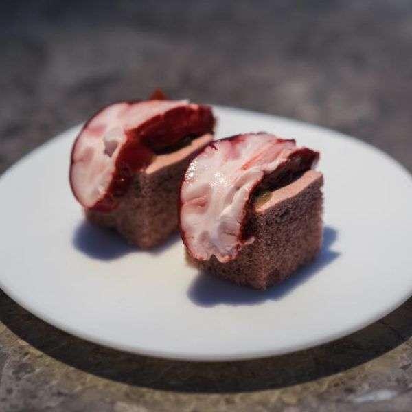 Lamb brain, cherry glaze, and onion meringue.