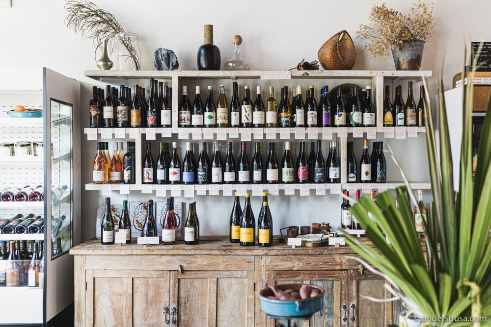 At the front of Botanica you'll find a market with many bottles of natural wine for sale.