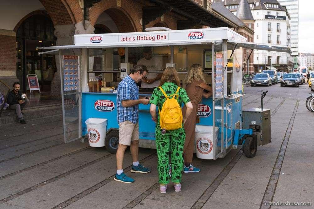 John's Hotdog Deli is a food truck located outside Copenhagen Central Station.
